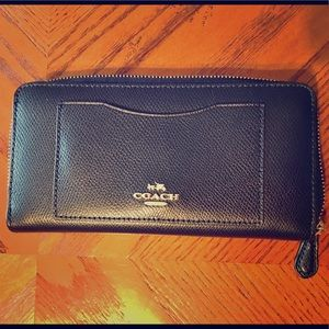 Navy Coach wallet with gold zipper